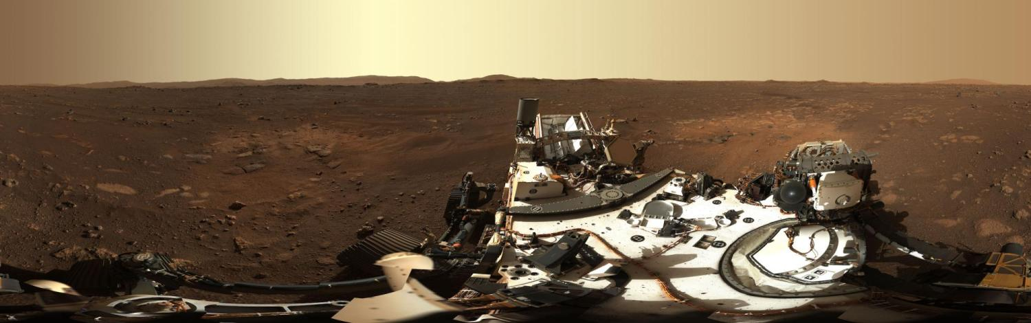 A panorama of the Martian landscape with part of the Perseverance rover in the foreground