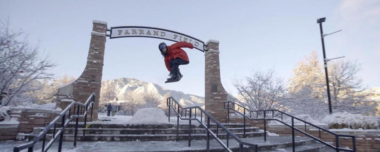 Student snowboarding at Farrand Field