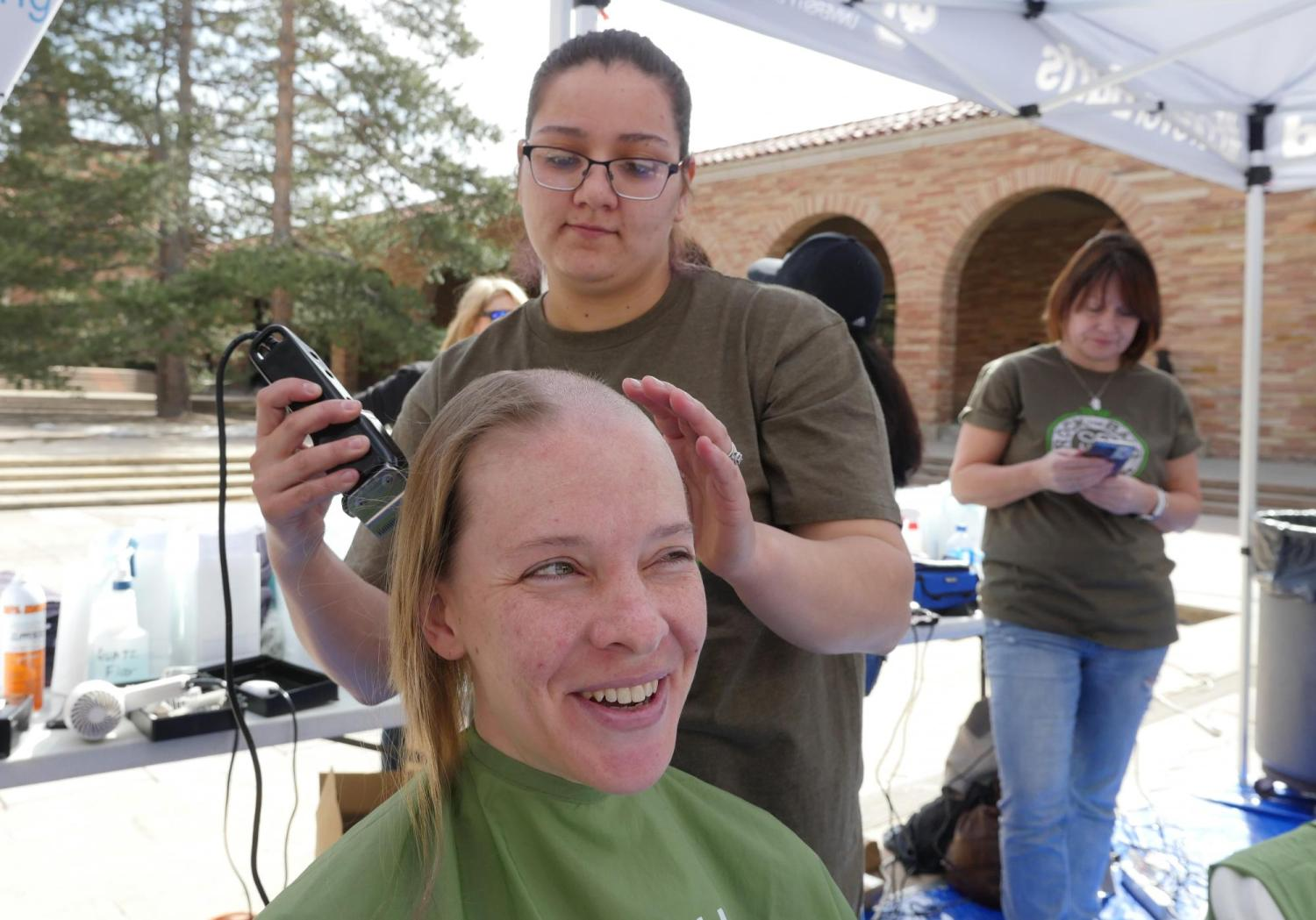 First-year ENVD student Nicole Elder donates her hair. Photo by Casey A. Cass.