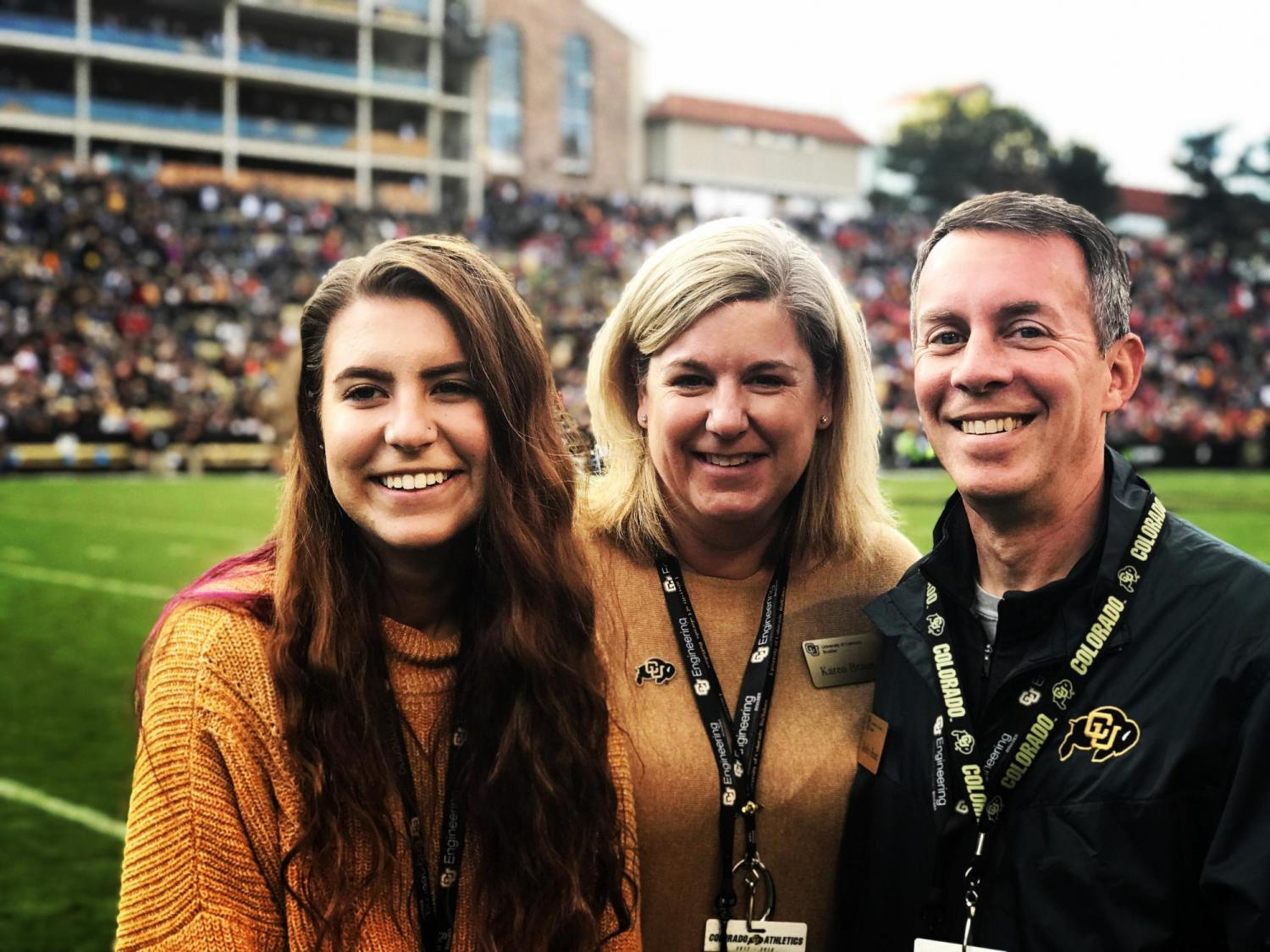 CU Boulder's Dean of Engineering and Applied Science Bobby Braun, his wife Karen, and his daughter attend a CU football game in the fall of 2018.