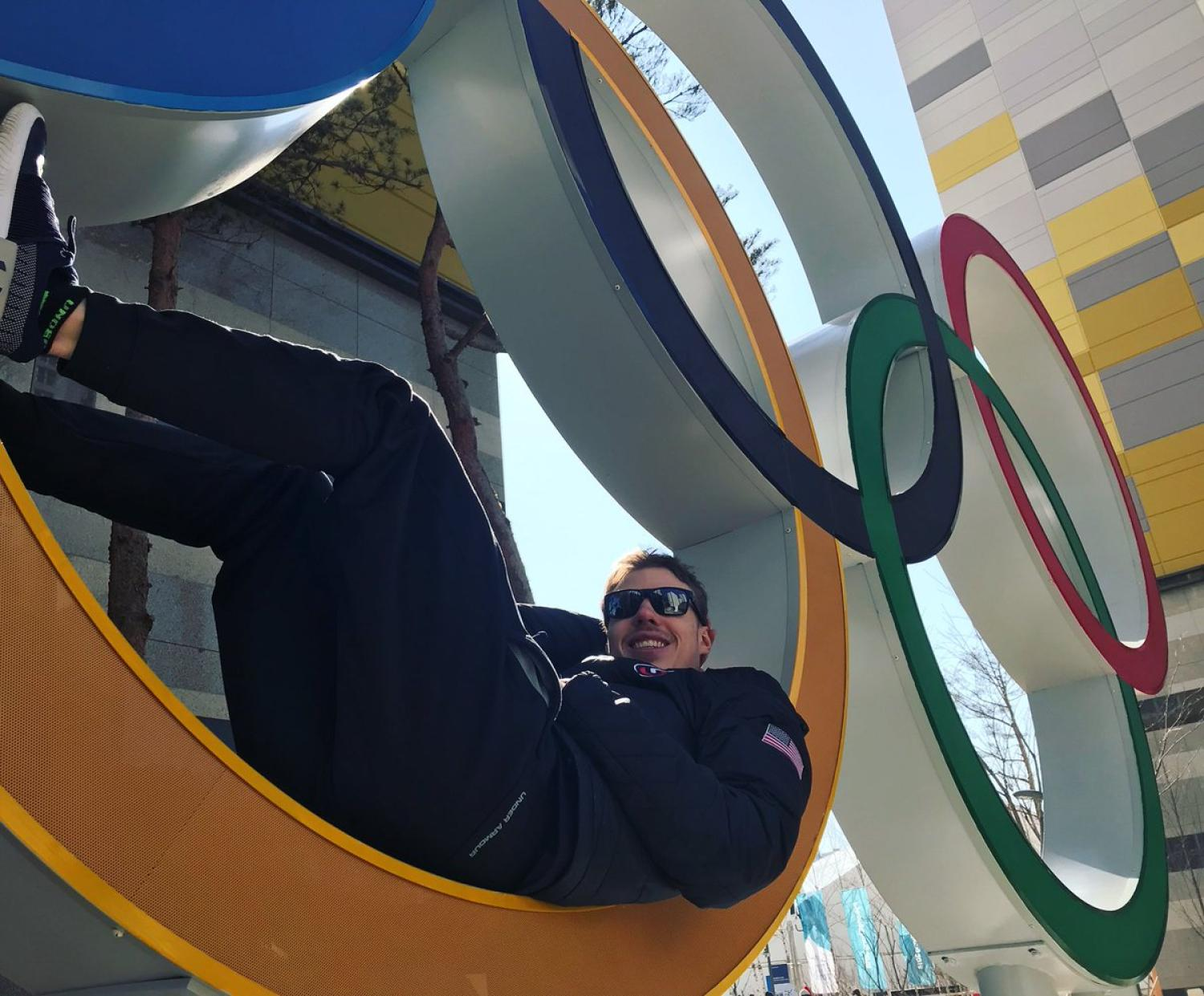 Brian Hansen sits in the Olympic rings