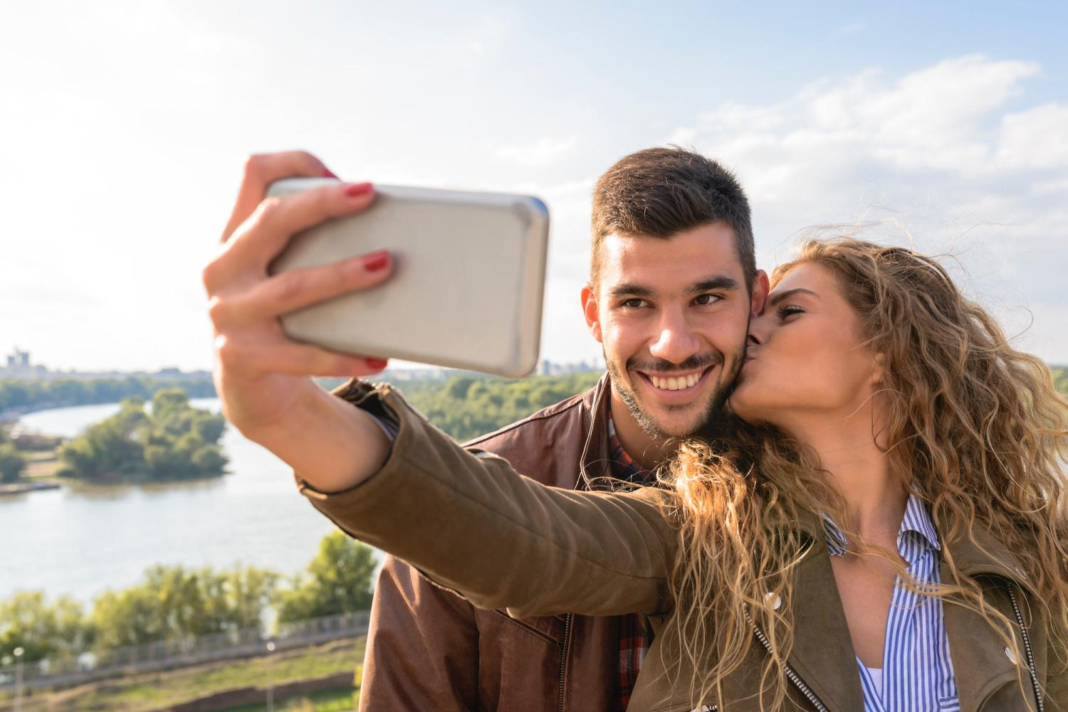 Couple taking a selfie with a smartphone