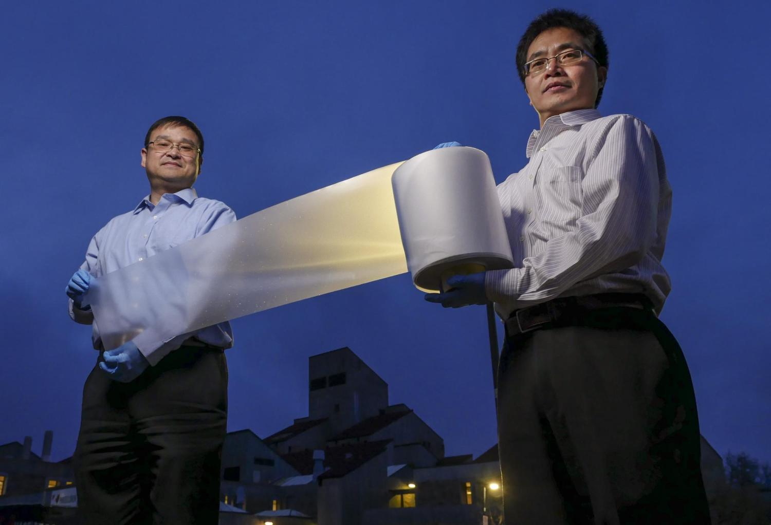 researchers with cooling material on a roll