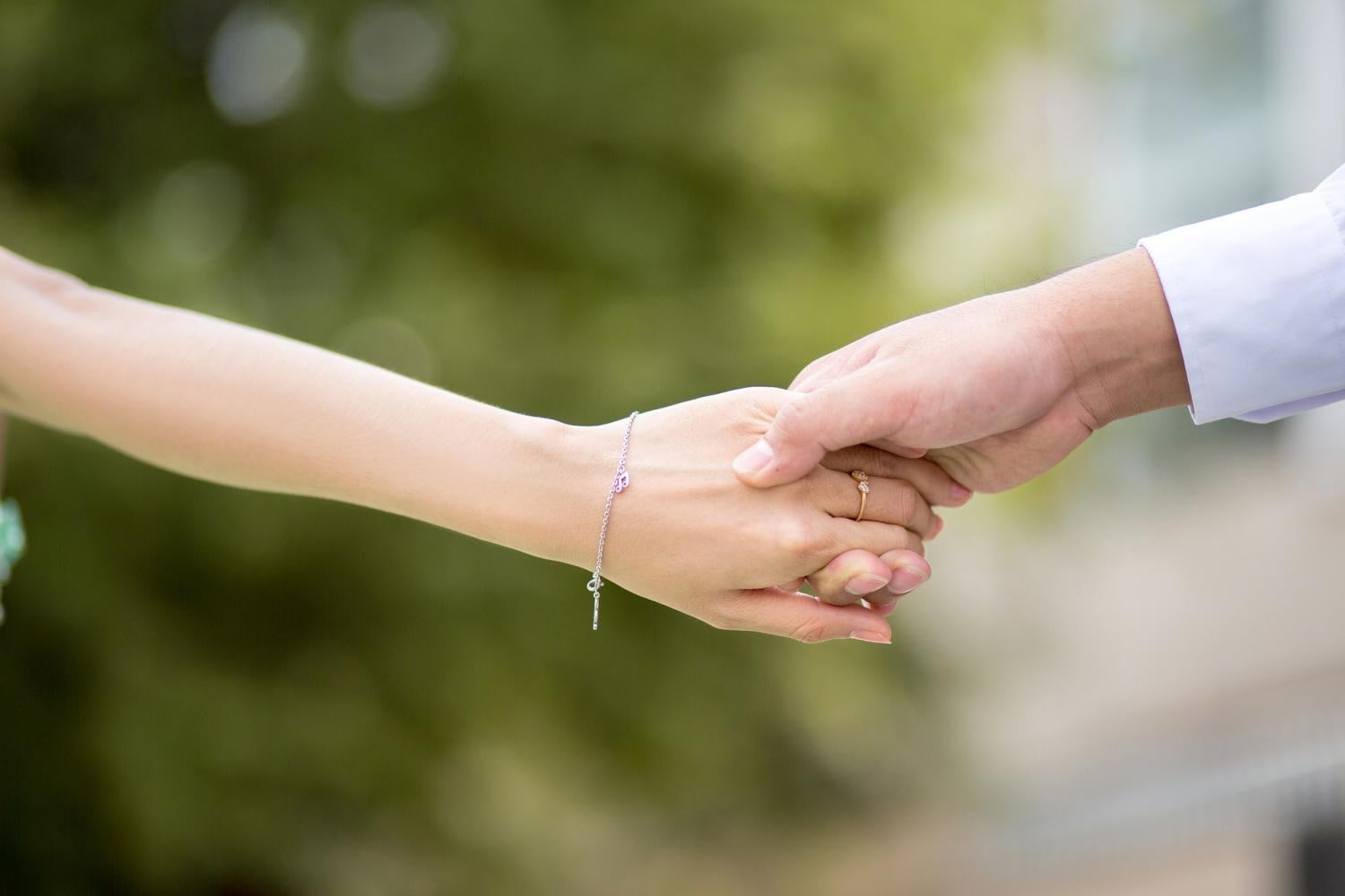 stock image of people holding hands