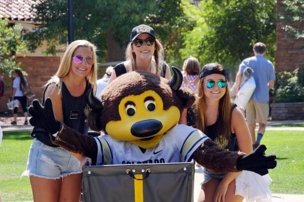 CU Boulder mascot in moving bin