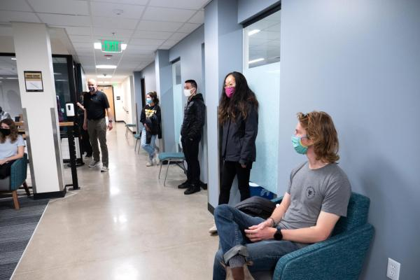 CU Boulder students wait in a campus building before embarking on a national study