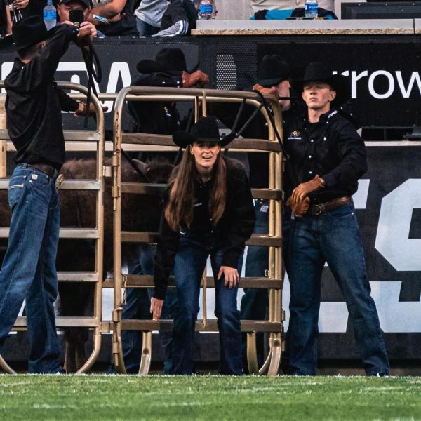 Taylor Stratton, center, getting ready to open the gate for Ralphie VI's inaugural run.