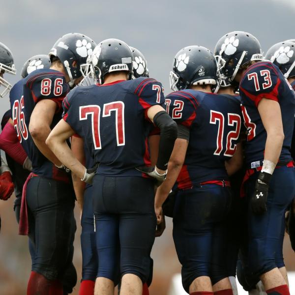 High school football team huddles up