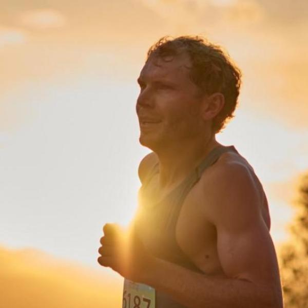 Jake Riley running at sunset