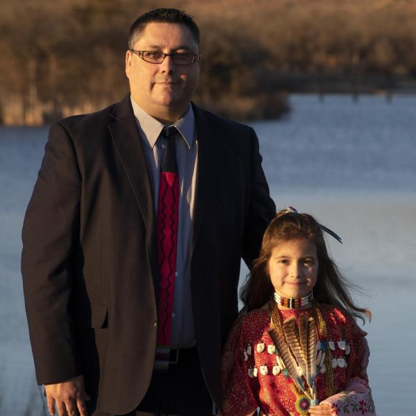 Justin Boos and his 9-year-old daughter dressed in traditional Native American clothing