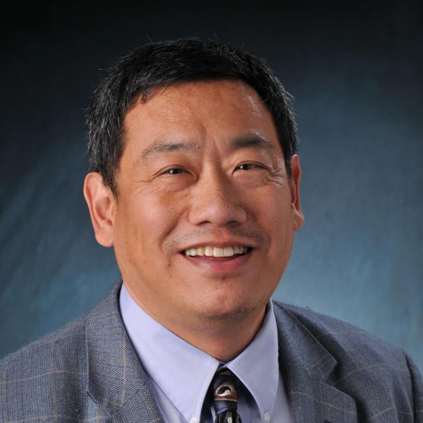 Headshot of Peter Huang.