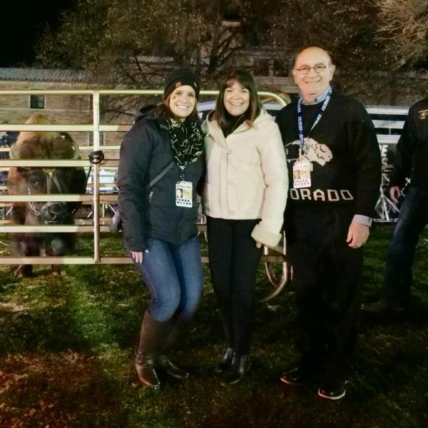 Chancellor Phillip DiStefano, right, poses with his wife, Yvonne, and daughter, Nicole, alongside Ralphie V ahead of Colorado's game against Washington on Saturday, Nov. 23, 2019. (Photo by Glenn Asakawa/University of Colorado)