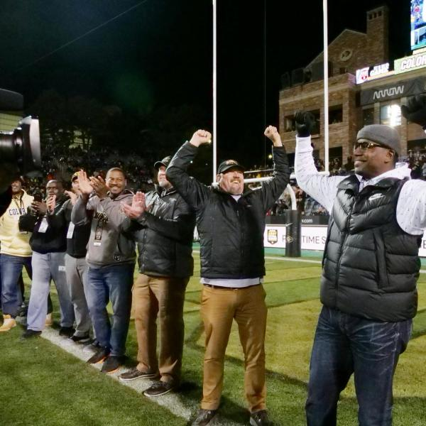 Kordell Stewart, right, joins teammates from the 1994 Miracle at Michigan team to be recognized on the field during Colorado's game against Washington on Saturday, Nov. 23, 2019. (Photo by Glenn Asakawa/University of Colorado)