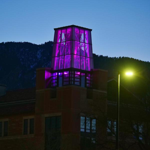 On March 5, the Roser ATLAS building shines magenta––part of the state of Colorado's COVID-19 anniversary remembrance. (Photo by Glenn Asakawa/CU Boulder)