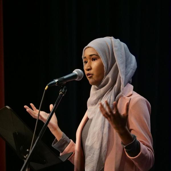 Heraa Hashmi, president of the CU Muslim Student Association, speaks at the MLK Day Celebration.