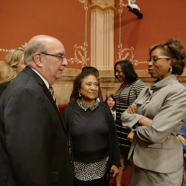 CU Boulder Chancellor Phil DiStefano, left, and professor Polly McLean, center, speak with State Senator Rhonda Fields.