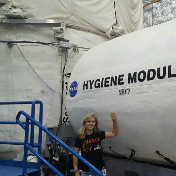 "Ulyana Horodyskyj stands outside the HERA ""Hygiene Module"""
