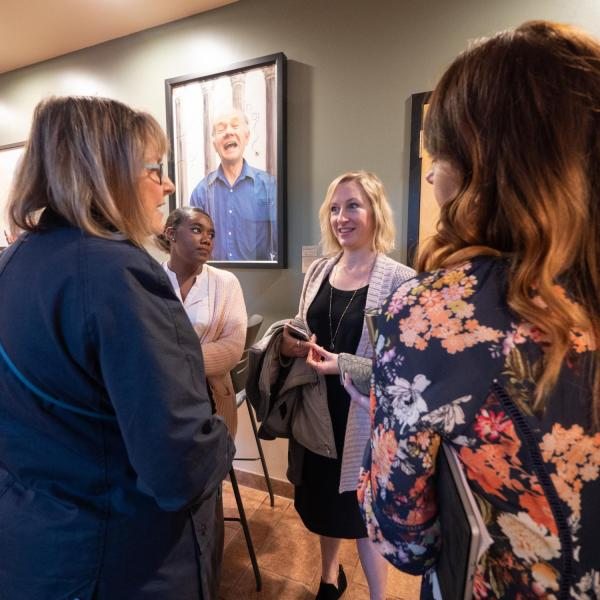 An informal discussion occurs after the session on a focus on racial equity: Boulder's Partnership with the Government Alliance on Racial Equity (GARE). Photo by Glenn Asakawa.