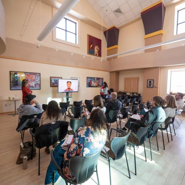 Participants watch a short video during a session on What the Heck is Intersectionality?! with Scarlet Bowen and Sarah Rimmel, Center for Inclusion and Social Change. Photo by Glenn Asakawa.