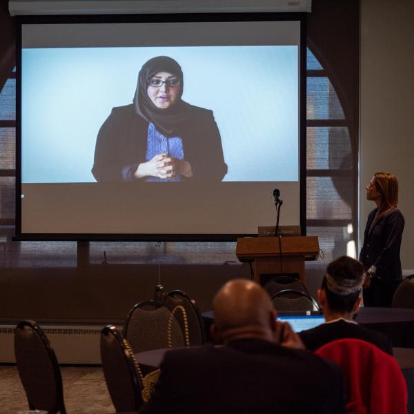 Erica Kuhl, vice president of Community at Salesforce, right, kicks off her talk titled Creative Inclusive Communities at Salesforce with a video. Photo by Glenn Asakawa.