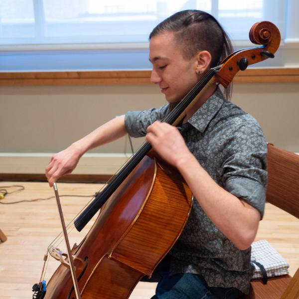 """A member of the CU Playback Theatre Ensemble plays at the start of a session titled """"Playing with Intention: Workshop & Performance"""" at the CU Boulder 2020 Spring Diversity Summit. (Photo by Glenn Asakawa/University of Colorado)"""