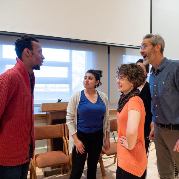 """Members of the CU Playback Theatre Ensemble chat before the start of a session titled """"Playing with Intention: Workshop & Performance"""" at the CU Boulder 2020 Spring Diversity Summit. (Photo by Glenn Asakawa/University of Colorado)"""