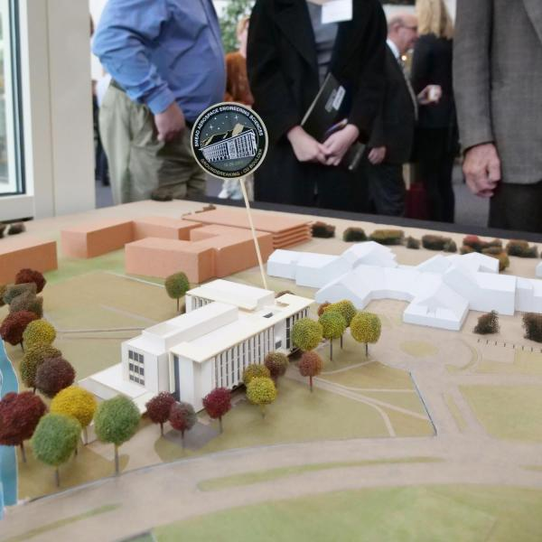 Onlookers check out a model of the new aerospace engineering sciences building