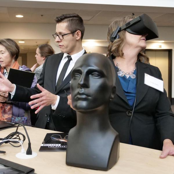 Robin Suitts, right, gets a virtual reality tour of the inside of the yet to be built aerospace building