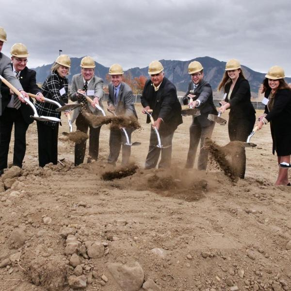 Left to right: Jay Lindell, Philip DiStefano, Ann Smead, Michael Byram, Bobby Braun, Glen Gallegos, Jack Kroll, Alexis Wall, Kathy Tobey and Brian Argrow shovel dirt at the Aerospace Engineering Science Building groundbreaking ceremony on CU Boulder's East Campus