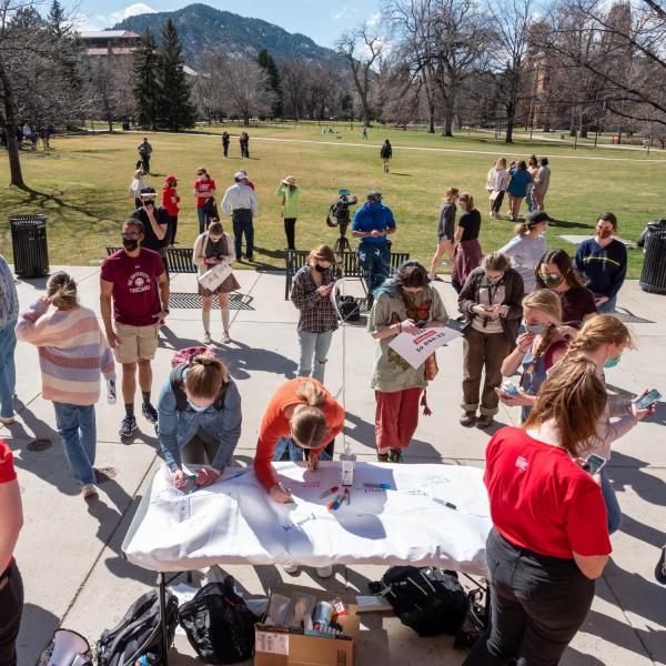 Students Demand Action at the University of Colorado Boulder host a rally on March 30 honoring the victims of the March 22, 2021 mass shooting in Boulder. (Photo by Patrick Campbell/University of Colorado)