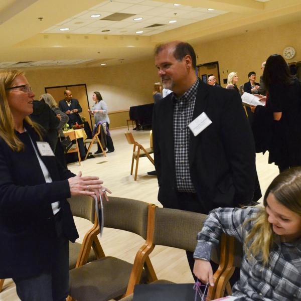 Campus community members gather to celebrate faculty achievements.