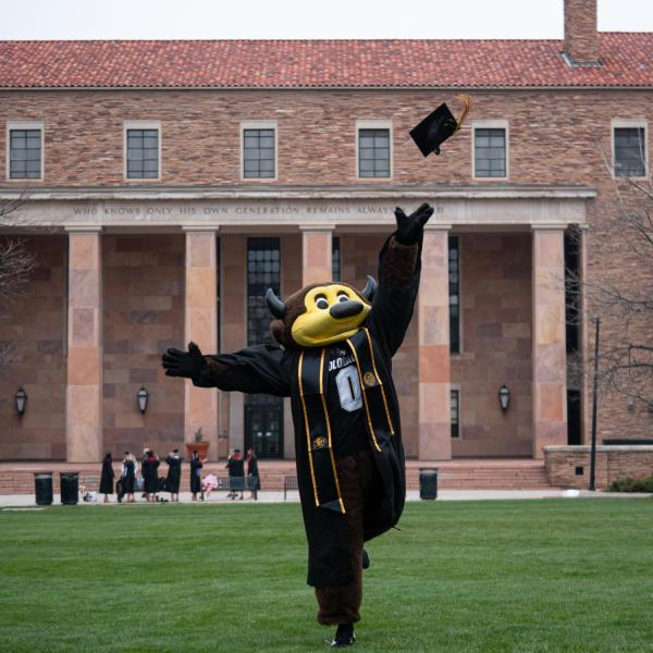 Chip, in regalia, joins others in celebrating 2021's CU Boulder commencement ceremony. (Photo by Glenn Asakawa/University of Colorado)