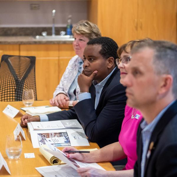 Congressman Joe Neguse (second from left) listens during a discussion about the work being done at CIRES. (Photo by Patrick Campbell/University of Colorado)