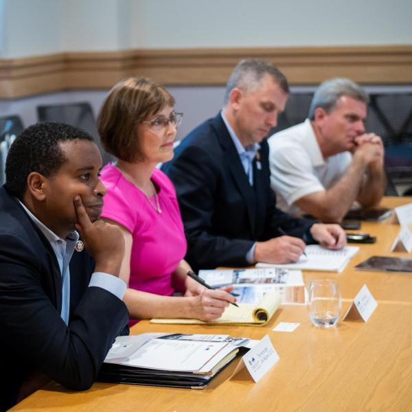 "Members of Congress (left to right) Joe Neguse, Kathy Castor, Sean Casten and Earl L. ""Buddy"" Carter listen during a discussion about the work being done at CIRES. (Photo by Patrick Campbell/University of Colorado)"