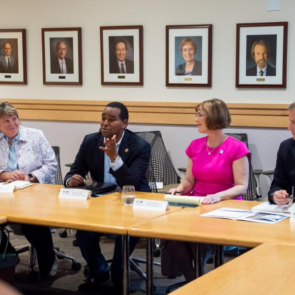 Rep. Joe Neguse (second from left) discusses a topic as Terri Fiez (left), Rep. Kathy Castor (second from right) and Rep. Sean Casten listen in. (Photo by Patrick Campbell/University of Colorado)