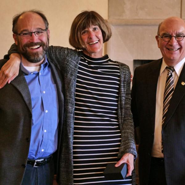 Professor Janet DeGrazia, center, is flanked by Chancellor Philip DiStefano and Associate Dean of Engineering Ken Anderson during the 12th Annual Convocation Awards and Presentations Celebrating Faculty Achievements. (Photo by Casey A. Cass/University of Colorado)
