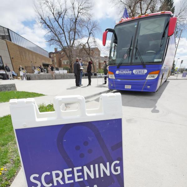 A mobile COVID-19 vaccination bus is parked at the Williams Village residence complex at CU Boulder. (Photo by Casey A. Cass/University of Colorado)