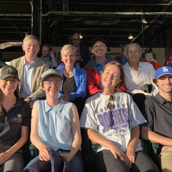 CU Boulder first-place international solar decathlon team members pose with U.S. Sen. John Hickenlooper (second row, left) and U.S. Secretary of Energy Jennifer Granholm (top row, second from left) during a game against the St. Louis Cardinals on July 1. (Photo provided)
