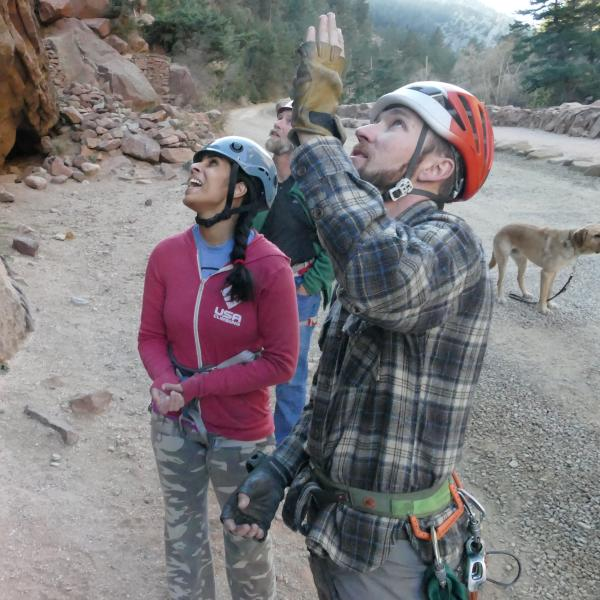 University of Colorado senior psychology major Esha Mehta gets some pointers from Paradox Sports Program Director Adam Fisher while rock climbing in Eldorado Canyon near Boulder. Mehta is a blind competitive rock climber.