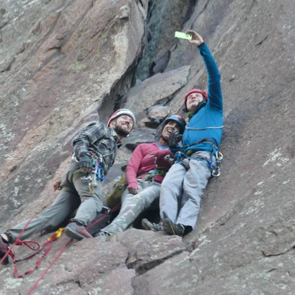 University of Colorado senior psychology major Esha Mehta, center, poses for a selfie with Paradox Sports Program Director Adam Fisher, left, and Ryan Pedersen while rock climbing in Eldorado Canyon near Boulder. Mehta is a blind competitive rock climber.