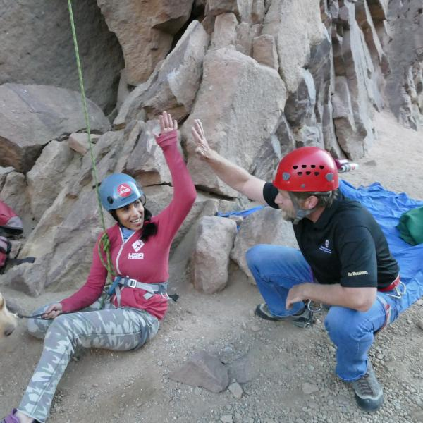 University of Colorado senior psychology major Esha Mehta gets a high five from Mike McNeil, Disability Access Coordinator at CU Boulder, while rock climbing in Eldorado Canyon. Mehta is a blind competitive rock climber.