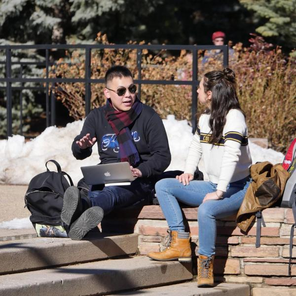 People on campus between classes on the first day back from winter break. Photo by Patrick Campbell.