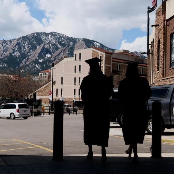 Graduates emerge from Folsom Field's concourse after getting their formal portraits taken during CU Boulder's Graduate Appreciation Days events. (Photo by Glenn Asakawa/University of Colorado)