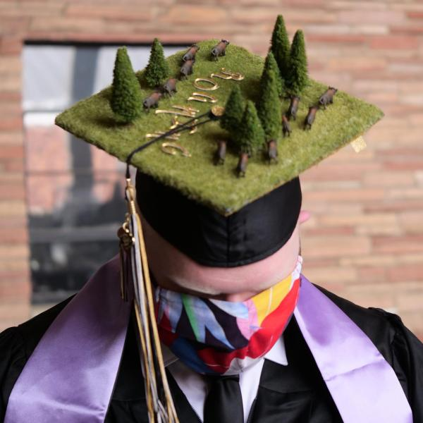 Aric McCarty sports a creatively decorated cap during CU Boulder's Graduate Appreciation Days events. (Photo by Glenn Asakawa/University of Colorado)