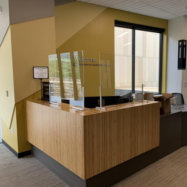 Protective measures, such as Plexiglas, are installed at customer service points on campus.