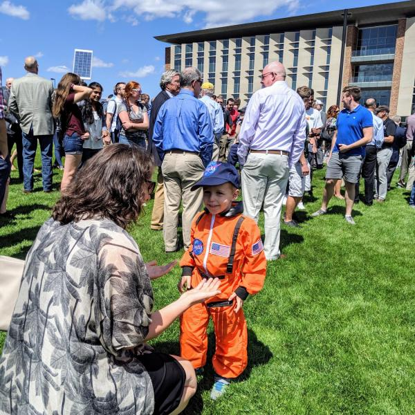 A future astronaut enjoys the ribbon-cutting ceremony for the new Aerospace Engineering Sciences Building at CU Boulder. (Photo by Casey A. Cass/CU Boulder)
