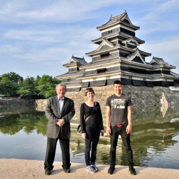 Kazunori Takato, CEO of Chiyoda Rubber Company, Danielle Rocheleau Salaz, Center for Asian Studies executive director; and Kaito Padilla, one of the first students participating in internships in Tokyo in front of Matsumoto Castle in Nagano Prefecture.