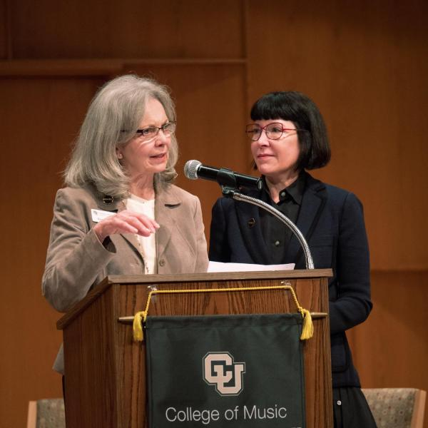 Rebecca Roser, chair of the Music + advancement campaign, left, and Michele Ritter, chair of the College of Music Advisory Board, speak during the groundbreaking ceremony. Photo by Glenn Asakawa.