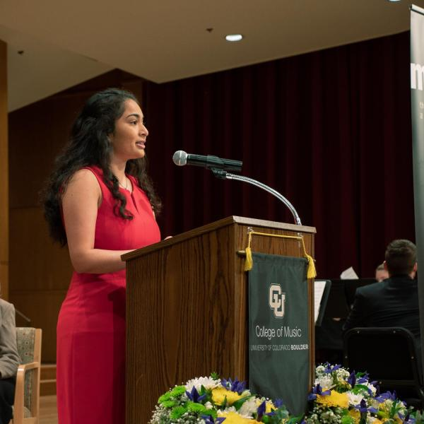 Anoushka Divekar, president of the College of Music Student Government, speaks in Grusin Hall during the groundbreaking ceremony. Photo by Glenn Asakawa.