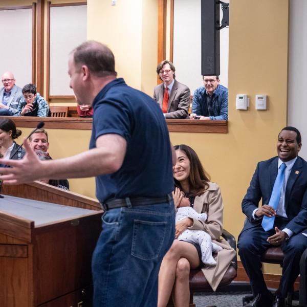 Gov. Jared Polis speaks before a ceremonial swearing-in event for U.S. Representative Joe Neguse. Photo by Glenn Asakawa.